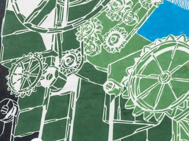 green, black, white, and blue textile